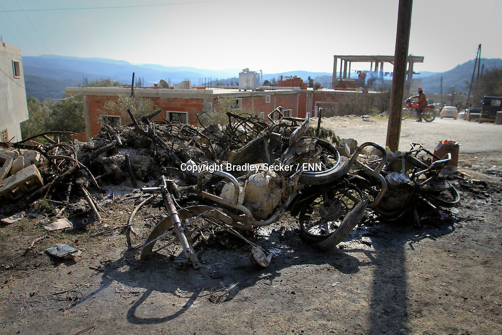 Motorcycles burnt during a raid by the Syrian army in a village surrounding Al Janoudiyah, Syria