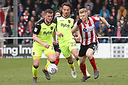 Lincoln City midfielder Elliott Whitehouse (4) sprints clear with the ball during the EFL Sky Bet League 2 match between Lincoln City and Exeter City at Sincil Bank, Lincoln, United Kingdom on 30 March 2018. Picture by Mick Atkins.