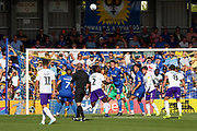 AFC Wimbledon defender Ryan Delaney (21) winning header and clearing the ball during the EFL Sky Bet League 1 match between AFC Wimbledon and Shrewsbury Town at the Cherry Red Records Stadium, Kingston, England on 14 September 2019.