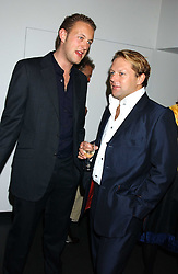 Left to right, LORD EDWARD SPENCER-CHURCHILL and DAVID ROSS co-founder of Carphone Warehouse at a private view of paintings by Rosita Marlborough (The Duchess of Marlborough) held at Hamiltons gallery, Carlos Place, London W1 on 9th November 2005.<br />