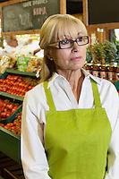 Senior market employee looking away