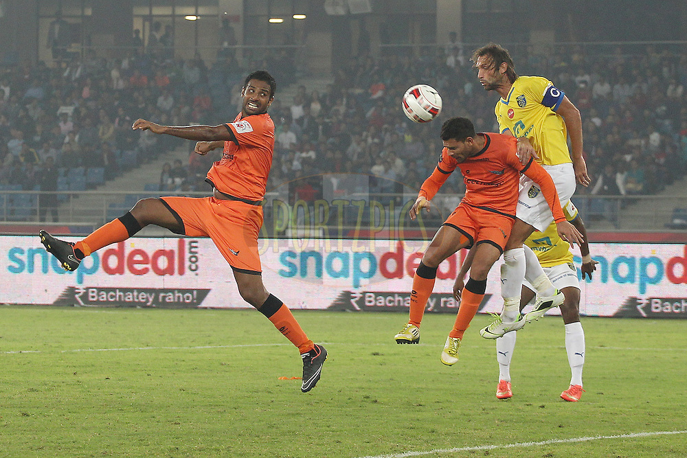 Anwar Ali of Delhi Dynamos FC and Cedric Hengbart of Kerala Blasters FC during match 33 of the Hero Indian Super League between The Delhi Dynamos FC<br /> and Kerala Blasters FC held at the Jawaharlal Nehru Stadium, Delhi, India on the 16th November 2014.<br /> <br /> Photo by:  Ron Gaunt / ISL/ SPORTZPICS