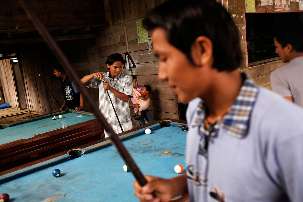 Teenagers play pool during the weekly market in the center of San Pedro Sumino in August of 2009.   This part of town livens up once a week and then dies during the rest of it.  The bars are only open on market days.