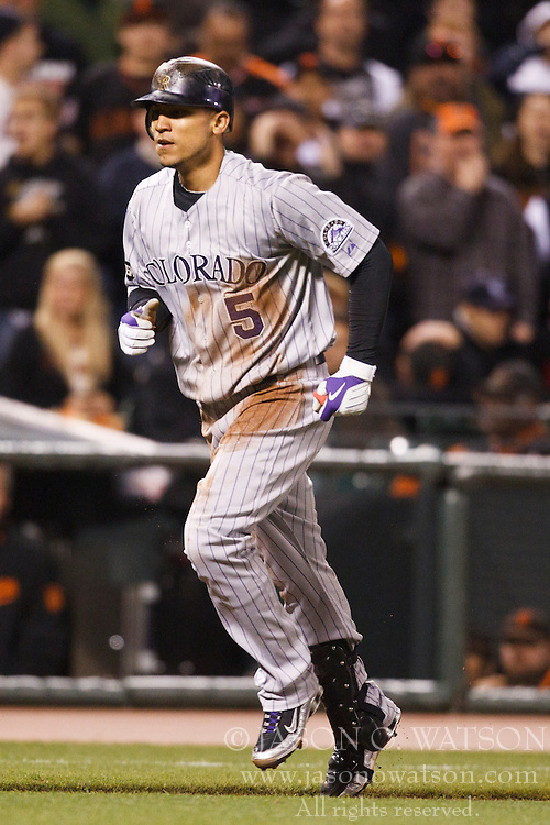 August 30, 2010; San Francisco, CA, USA;  Colorado Rockies center fielder Carlos Gonzalez (5) advances to home plate on a throwing error to score the game winning run during the ninth inning against the San Francisco Giants at AT&T Park.  Colorado defeated San Francisco 2-1.