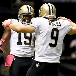 October 7, 2012; New Orleans, LA, USA; New Orleans Saints quarterback Drew Brees (9) celebrates with wide receiver Devery Henderson (19) to break the NFL record for consecutive games throwing a touchdown at 48 games eclipsing a record once held by Johnny Unitas during the first quarter of a game against the San Diego Chargers at the Mercedes-Benz Superdome. Mandatory Credit: Derick E. Hingle-US PRESSWIRE