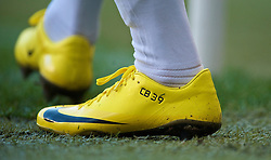 MANCHESTER, ENGLAND - Sunday, January 31, 2010: The yellow Nike boots of Manchester City's Craig Bellamy during the Premiership match at the City of Manchester Stadium. (Photo by David Rawcliffe/Propaganda)