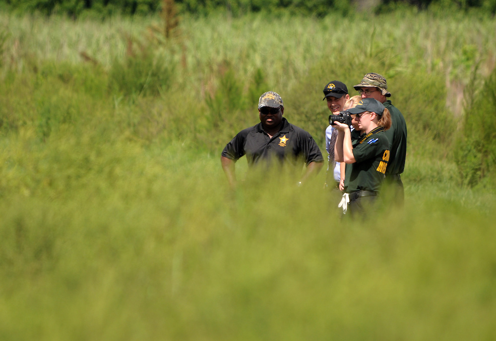 Andrew Knapp, FLORIDA TODAY -- Aug. 18, 2011 -- Investigators from the Brevard County Sheriff's Office work a scene where a decaying body was found early Thursday in swampland 100 yards west of Interstate 95 near the State Road 520 interchange in the Cocoa area.