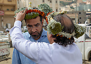 "FLOWER POWER IN SAUDI ARABIA<br /> ""You have 15 minutes to take pictures, then we gotta leave. Those people are crazy! Do it quickly please!"" My police escort was nervous, because visiting the Flower Men in the deep south of Saudi Arabia was a real headache. And obviously, they know the situation better than anyone, as they were part of the Qahtani tribe living in the Jizan and Asir southern provinces. This scene happened during my trip ten years ago.<br /> <br /> No tourists were allowed ever since until December, 2018. The closed kingdom finally cracked the door open for tourists again, only for a few weeks though, thanks to Supercoppa Italiana Juventus Vs Milan in Jeddah. Such a rare opportunity to visit Flower Men another time, and see how they deal with the war against their cousins in Yemen as well as the shy opening of the Kingdom.<br /> <br /> You know for sure when you arrive in the area of the Flower Men, because you will notice the incredible watchtowers and houses built like small castles. On one hand, these defensive architectural elements indicate that the locals are living in the fear of constant attacks for centuries. On the other hand, this also has given them a very sturdy character and a fierce spirit of independence.<br /> Interestingly, those tough fighters also come with tender hearts in this peninsula, as they all desire to look attractive. You won't see them wearing the traditional keffieh, instead, the descendants of the ancient legendary Tihama and Asir tribes love to wear colorful garlands in their daily life.<br /> The first to have studied this tribe was the late french researcher Thierry Mauger. In the 80's , he traveled around the area and took pictures to make a book. He got into a lot of troubles and was even nearly raped by male villagers! <br /> I believed it was a smart idea to bring back his old photo book in the villages. However, it was not. As soon as I opened it in front of the Flower Men, they were shocked to see their women's pictures inside. The community had"