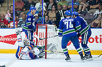 PENTICTON, CANADA - SEPTEMBER 16: Drake Caggiula #36 of Edmonton Oilers collides with Thatcher Demko #35 of Vancouver Canucks on September 16, 2016 at the South Okanagan Event Centre in Penticton, British Columbia, Canada.  (Photo by Marissa Baecker/Shoot the Breeze)  *** Local Caption *** Thatcher Demko; Drake Caggiula;