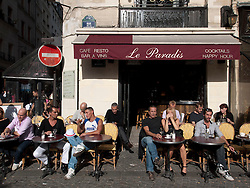Typical busy pavement cafe in the Marais district of Paris France