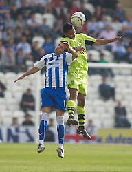 COLCHESTER, ENGLAND - Saturday, April 24, 2010: Tranmere Rovers' Shaleum Logan and Colchester United's Simon Hackney in action during the Football League One match at the Western Community Stadium. (Photo by Gareth Davies/Propaganda)