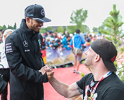 03.07.2016, Red Bull Ring, Spielberg, AUT, FIA, Formel 1, Grosser Preis von Österreich, Red Carpet, im Bild Lewis Hamilton (GBR) Mercedes AMG Petronas F1 Team // British Formula One driver Lewis Hamilton of Mercedes AMG F1 during the Red Carpet for the Austrian Formula One Grand Prix at the Red Bull Ring in Spielberg, Austria on 2016/07/03. EXPA Pictures © 2016, PhotoCredit: EXPA/Dominik Angerer