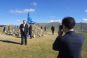TERELJ, MONGOLIA..09/04/2001.Ovoo (stone heap to honour local patron gods) visited by Chinese Official Group..(Photo by Heimo Aga)