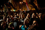 On the eighteenth day of protests in Tahrir Square, Cairo, Egyptian protester wave flags and chant slogans calling for the ouster of President Hosni Mubarak, who has ruled the country for thirty years.