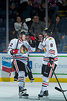 KELOWNA, BC - OCTOBER 20: Kieffer Bellows #22 and Cody Glass #8 of the Portland Winterhawks celebrate a third period empty net goal against the Kelowna Rockets at Prospera Place on October 20, 2017 in Kelowna, Canada. (Photo by Marissa Baecker/Getty Images)