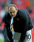 Wayne Rooney (Manchester United) spits out water during warm up before the UEFA Champions League Quarter Final second leg match between Manchester United and Bayern Muenchen at Old Trafford on April 7, 2010 in Manchester, England.