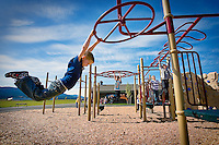 JEROME A. POLLOS/Press..Spencer Heinen, 8, swings on the playground equipment at the new West Ridge Elementary in Post Falls during the first day of school Tuesday.