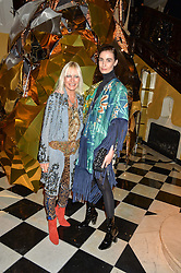Left to right, VIRGINIA BATES and ERIN O'CONNOR at a party to celebrate theunveiling of the Claridge's Christmas Tree designed by Christopher Bailey for Burberryheld at Claridge's, Brook Street, London on 18th November 2015.