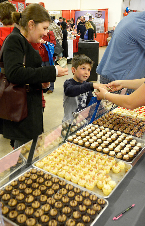 gbs032617c/ASEC -- Melisa Santaroce of Albuquerque, left, buys a mini cupcake for her son Nathaniel Volf, 6, at the Cake Fetish booth at the Southwest Chocolate & Coffee Fest at the Expo NM State Fairgrounds on Sunday, March 26, 2017. (Greg Sorber/Albuquerque Journal)