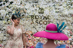 © Licensed to London News Pictures. 19/06/2018. London, UK.  A young woman poses for a photograph while attending day one of Royal Ascot at Ascot racecourse in Berkshire, on June 19, 2018. The 5 day showcase event, which is one of the highlights of the racing calendar, has been held at the famous Berkshire course since 1711 and tradition is a hallmark of the meeting. Top hats and tails remain compulsory in parts of the course. Photo credit: Ben Cawthra/LNP