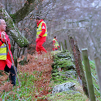 Comrie Missing man...6.12.99.(File Pic)<br />Members of the Tayside Police Search and Rescue Unit<br />searching the Glen Lednock and Deil's Caldron area of woodland and hillside at the edge of Comrie, Perthshire.<br /><br />Picture Copyright John Lindsay.<br />Perthshire Picture Agency<br />Tel: 01738 623350  Mobile: 07775 852112