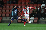 Nicky Adams (C) and Kevin Dawson   during the EFL Sky Bet League 2 match between Cheltenham Town and Bury at LCI Rail Stadium, Cheltenham, England on 5 March 2019.