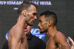 Las Vegas, Nevada, USA - July 4, 2014: George Roop (left) and Rob Font (right) pose after weighing in for their preliminary card bout at UFC 175 at the Mandalay Bay Events Center in Las Vegas, Nevada.  Ed Mulholland for ESPN