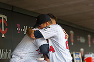 Trevor Plouffe #24 and Oswaldo Arcia #31 of the Minnesota Twins hug in the dugout before a game against the Kansas City Royals on June 27, 2013 at Target Field in Minneapolis, Minnesota.  The Twins defeated the Royals 3 to 1.  Photo by Ben Krause