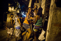 Residents in the streets of Rocinha, the biggest favela in Brazil, with over 100,000 residents, in Rio de Janeiro, Br., on Thursday, Jan. 24, 2013. In early November 2011 about 3,000 police officers and soldiers moved into one of the largest slums in Latin America in an effort by the Brazilian government to assert control over lawless areas of the city ahead of the 2014 World Cup and 2016 Summer Olympics.