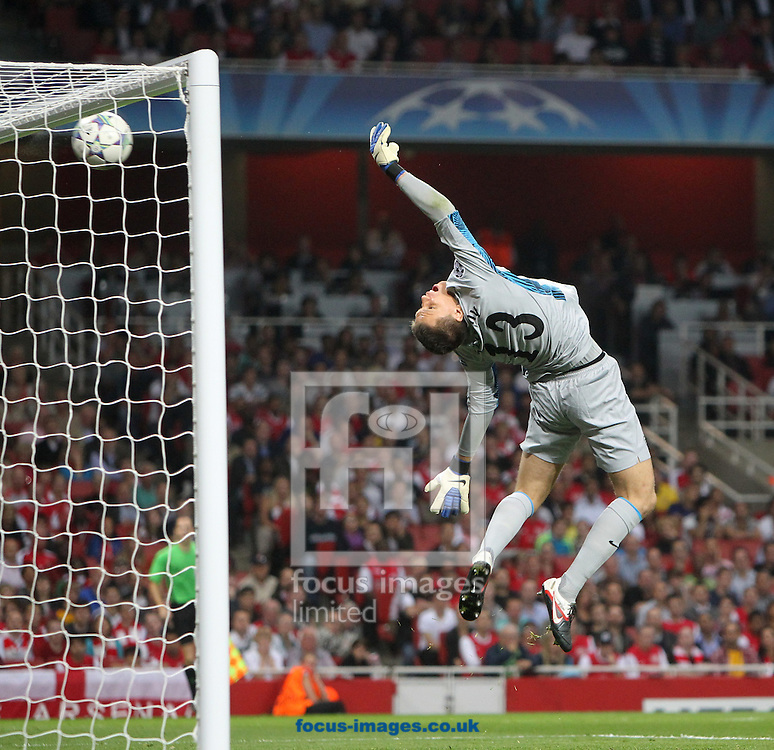 Picture by Paul Chesterton/Focus Images Ltd. 07904 640267.28/9/11.Wojciech Szczesny of Arsenal is beaten by Vasilis Torosidis (Captain) of Olympiakos shot but it rebounds off the crossbar during the UEFA Champions League Group F match at The Emirates Stadium, London.