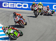 Jul 12-13 2014 U.S.A # 1 Tom Sykes,# 50 Sylvain Guintoli, # 34 David Giugliano,# 24 Toni Elias,# 65 Jonathan Rea and # 58 Eugene Laverty battle for the number one position coming into the corkscrew  during the FIM Superbike World Championship Laguna Sega, Salinas ca