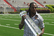 Fomer Rebel Dexter McCluster was presented the College Football Performance Award by Dr. Harold Smith during halftime of Mississippi's Grove Bowl in Oxford, Miss. on Saturday, April 17, 2010.