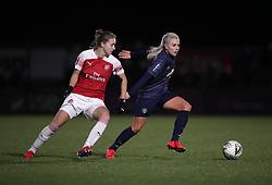 Arsenal Women's Vivianne Miedema (left) and Manchester United Women's Alex Greenwood battle for the ball