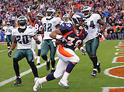 DENVER - OCTOBER 30:  Fullback Kyle Johnson #39 of the Denver Broncos runs away from Eagles defenders as he scores a touchdown for a 14-0 lead on a 6 yard catch in the first quarter against the Philadelphia Eagles on October 30, 2005 at INVESCO Field at Mile High in Denver, Colorado. The Broncos defeated the Eagles 49-21. ©Paul Anthony Spinelli *** Local Caption *** Kyle Johnson