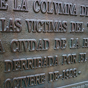 "One of two plaques on teh Cuban American Friendship Urn in Washington DC. The plaque reads: ""ESTA COPA FUE ESCULPIDA EN UN FRAGMENTO DE LA COLUMNA DE MARMOL DEL MONUMENTO A LAS VICTIMES DEL ""MAINE"". ERICIDO EN LA CIUDAD DE LA HABANA, CUYA COLUMNA FUE DERRIBADA POR EL CICLON DE 20 DE OCTUBRE DE 1926."" It translates as: ""This urn was sculpted from a fragment of the marble column monument to the ""Maine"" victims killed in the city of Havana, whose column was demolished by the cyclone of October 20, 1926."" Located in East Potomac Park in Washington DC, the Cuban American Friendship Urn is a 7-ton white marble urn carved from one of the columns that was originally part of the Maine Monument in Havana, Cuba, that memorialized the sinking of the Maine, an event that helped spark the Spanish American War and led to the independence of Cuba from Spain."