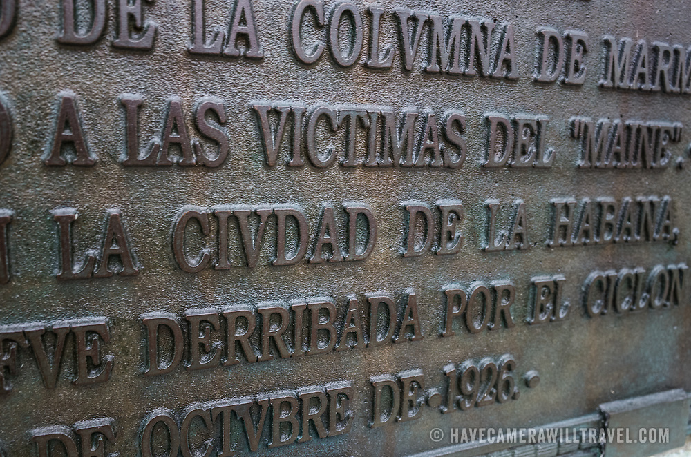 """One of two plaques on teh Cuban American Friendship Urn in Washington DC. The plaque reads: """"ESTA COPA FUE ESCULPIDA EN UN FRAGMENTO DE LA COLUMNA DE MARMOL DEL MONUMENTO A LAS VICTIMES DEL """"MAINE"""". ERICIDO EN LA CIUDAD DE LA HABANA, CUYA COLUMNA FUE DERRIBADA POR EL CICLON DE 20 DE OCTUBRE DE 1926."""" It translates as: """"This urn was sculpted from a fragment of the marble column monument to the """"Maine"""" victims killed in the city of Havana, whose column was demolished by the cyclone of October 20, 1926."""" Located in East Potomac Park in Washington DC, the Cuban American Friendship Urn is a 7-ton white marble urn carved from one of the columns that was originally part of the Maine Monument in Havana, Cuba, that memorialized the sinking of the Maine, an event that helped spark the Spanish American War and led to the independence of Cuba from Spain."""