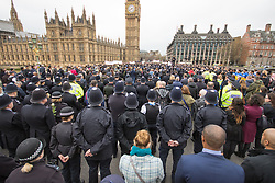 Westminster, London, March 29th 2017. Police officers, members of the emergency services and a large contingent of Muslims from across the UK as well as members of the public march across Westminster Bridge, exactly a week after the terror attack. PICTURED: The crowd observes a moment of silence.