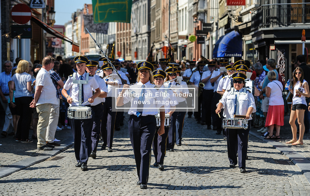 A marching band in the Grote Markt, Bruges, Belgium as part of the celebrations of Belgium's National Day on 22nd July.<br /> <br /> (c) Andrew Wilson   Edinburgh Elite media