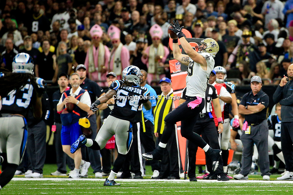 Oct 16, 2016; New Orleans, LA, USA; New Orleans Saints tight end Josh Hill (89) catches a pass over Carolina Panthers outside linebacker Shaq Green-Thompson (54) during the second quarter of a game at the Mercedes-Benz Superdome. Mandatory Credit: Derick E. Hingle-USA TODAY Sports