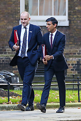 © Licensed to London News Pictures. 22/10/2019. London, UK. Minister of State for The Northern Powerhouse and Local Growth JAKE BERRY (L) and Chief Secretary to The Treasury RISHI SUNAK (R) arrives in Downing Street to attend the weekly cabinet meeting. Photo credit: Dinendra Haria/LNP