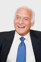 Happy elderly businessman against white background