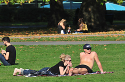 © Licensed to London News Pictures. 10/10/2018<br /> GREENWICH, UK.<br /> Sunbathing in the October sun.<br /> An autumnal Greenwich Park,Greenwich on a sunny October day in London, temperatures at around 22C.<br /> Photo credit: Grant Falvey/LNP