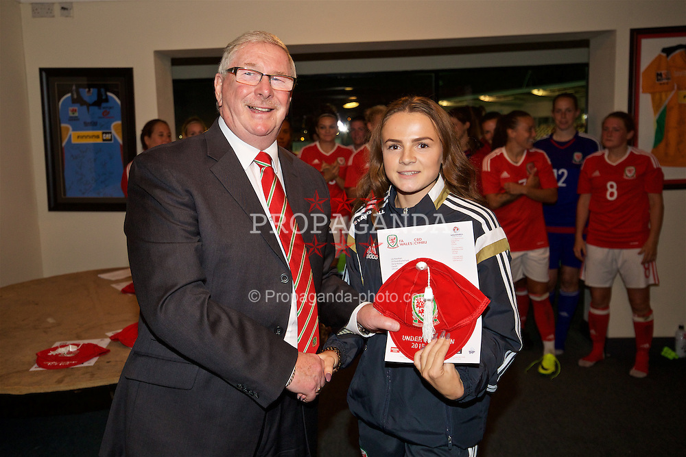 CARDIFF, WALES - Friday, August 19, 2016: Wales' Lily Woodham is presented with her Under-17 cap by FAW President David Griffiths at Rodney Parade. (Pic by David Rawcliffe/Propaganda)