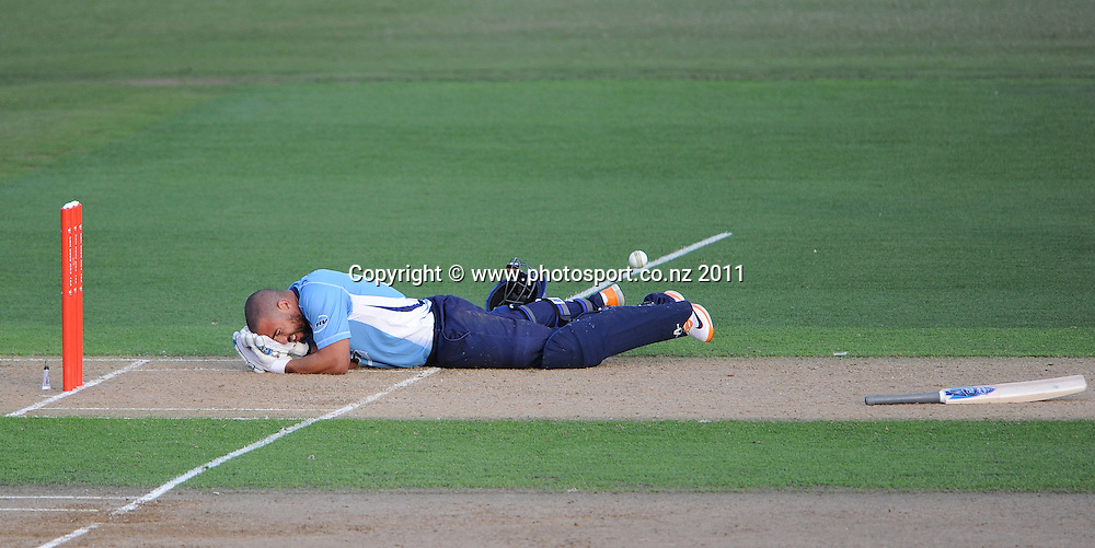 An injured Andre Adams after being hit by a Tim Southee bouncer during the HRV Twenty20 Cricket match between the Auckland Aces and Northern Knights at Colin Maiden Oval in Auckland on Monday 26 December 2011. Photo: Andrew Cornaga/Photosport.co.nz
