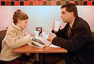 6 FEB. 2010 -- ST. PETERS, Mo. -- Emma Guenther (left), 9, and her father John stop for dinner at Jimmy John's on Mexico Road in St. Peters before attending the Father-Daughter Sweetheart Dance at St. Peters City Hall Feb. 6, 2010 in St. Peters, Mo. Photo © copyright by Sid Hastings