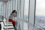 woman photographing the view from Tokyo City View deck in the Mori Tower Roppongi