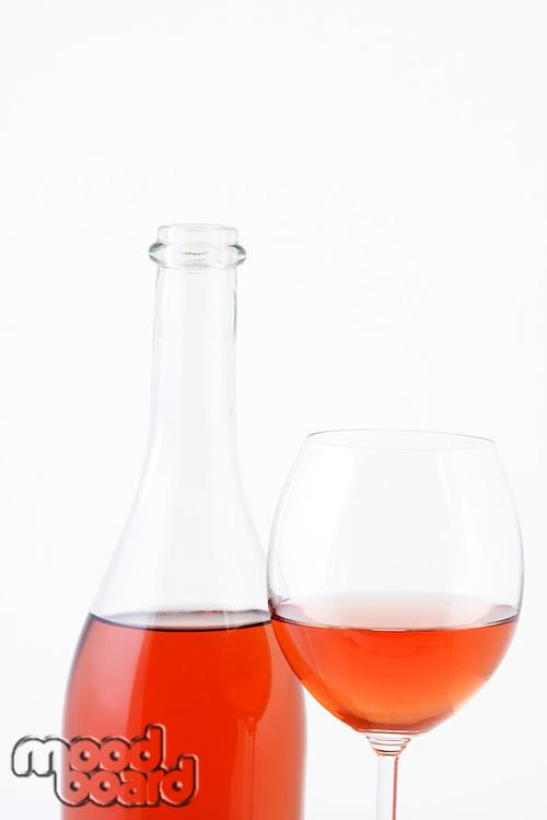 Close-up of rose wine on white background