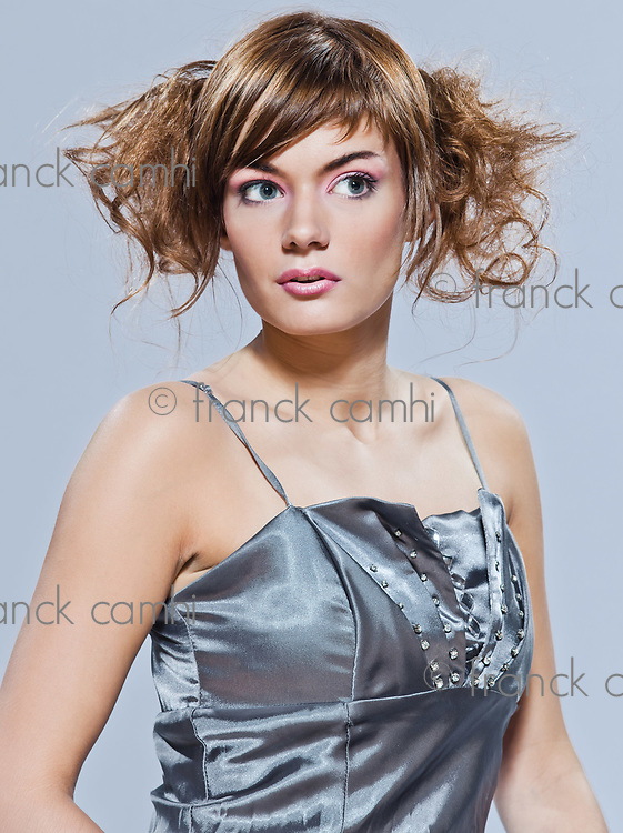 beautiful young caucasian woman girl evening dress on studio isolated plain background