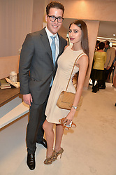 ZARA ZOFFANY and TOM BUCHANAN grandson of Nicholas Parsons at a party to celebrate the re-launch of the Ghost Flagship store at 120 King's Road, London on 15th April 2015.