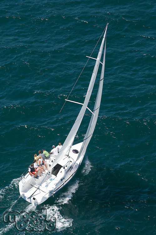 Yacht competes in team sailing event California aerial view